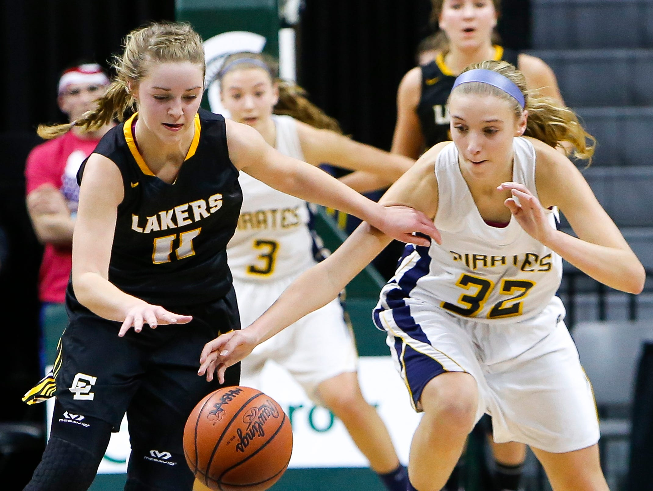 P-W's Emily Spitzley tries to take the ball away from Allie Bonzelet of Maple City Glen Lake Thursday, March 16, 2017, during the Class B Semifinal at the Breslin in East Lansing. P-W won 64-51.