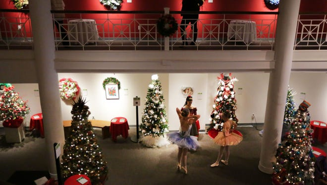 Ballerinas (from left) Annika Schmidt, Mary McDonald and Emily Hopp from the Makaroff Youth Ballet are on hand Sunday to greet visitors during the Festival of Trees at the Trout Museum of Art in downtown Appleton.