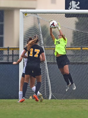 Toms River native Alyssa Dellacqua makes one of her many saves in goal for Charleston Southern.