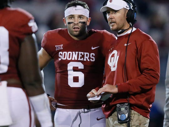 FILE - In this Nov. 11, 2017, file photo, Oklahoma head coach Lincoln Riley, right, talks with quarterback Baker Mayfield (6) in the first quarter of an NCAA college football game against TCU, in Norman, Okla. The Browns rookie quarterback Baker Mayfield believes Riley is ready to make the jump to the NFL. Mayfield played for Riley in college and has a strong relationship with his former coach. (AP Photo/Sue Ogrocki, File)