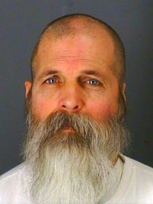 In this undated photo provided by the Oneida County Sheriff's Office in Oriskany, N.Y., 54-year-old Leon Tennant is shown. Tennant was charged with first-degree burglary for allegedly confronting a woman with a knife after breaking into her Vienna, N.Y. home on Dec. 20, 2013. Police said the woman grabbed the man's beard and caused some hair to be pulled out as he fled. DNA tests on the hair sample led police to Tennant. (AP Photo/Oneida County Sheriff's Office)