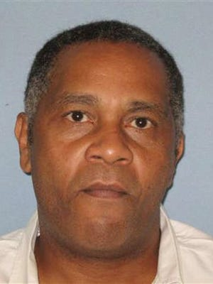 In this undated photo made available by the Alabama Department of Corrections, shows inmate Anthony Ray Hinton. Hinton, who spent nearly 30 years on death row will go free Friday, April 3, 2015,  after prosecutors told a court that there is not enough evidence to link him to the 1985 murders he was convicted of committing.