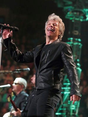 "FILE - In this Friday, March 31, 2017, file photo, Jon Bon Jovi of the band Bon Jovi performs in concert during their ""This House Is Not for Sale Tour"" at The Wells Fargo Center in Philadelphia. The group was performing at PPG Paints Arena in Pittsburgh on Wednesday, April 5, 2017, when Jon Bon Jovi told the audience he has had a cold since Saturday night. But he said he would keep pushing on. He sang ""Bad Medicine"" and wrapped things up after 90 minutes of the expected two-and-a-half hour show with ""Livin' on a Prayer."""
