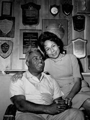 FILE - In this 1962 file photo, former baseball player Jackie Robinson and his wife, Rachel, pose in their Connecticut home in 1962. The first statue in Dodger Stadium history belongs to Jackie Robinson. The team will unveil his likeness during Jackie Robinson Day festivities on Saturday, April 15, 2017, with his wife and extended family in attendance on the 70th anniversary of him breaking baseball's color barrier.