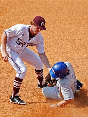Kentucky's Matt Reida, right, slides safely into second on a steal in the ninth inning as Mississippi State's Matthew Britton defends in an NCAA college baseball game during the Southeastern Conference tournament in Hoover, Ala., Thursday, May 24, 2012. (AP Photo/Dave Martin)