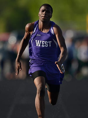 Green Bay West's Dontae Williams races towards the finish line while competing in the 100-meter dash finals during the WIAA Division 1 regional tack and field meet at Bay Port High School in Suamico on Tuesday, May 26, 2015.