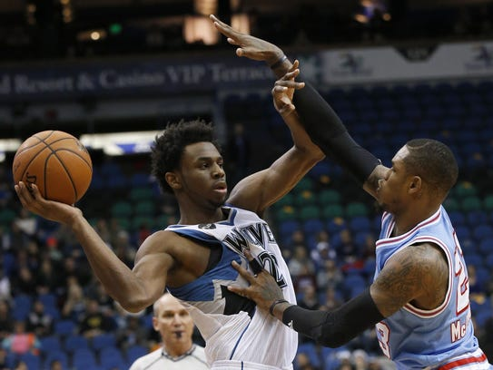 Minnesota Timberwolves guard Andrew Wiggins, left,