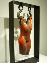 A hot sculpted blown glass and steel work by artist
