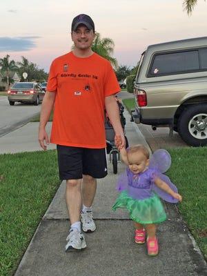 Isabella and Daddy Duty columnist Tim Walters walk around the neighborhood trick or treating on Halloween night.