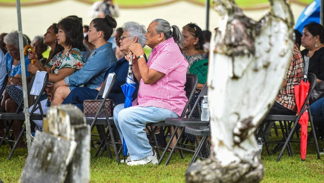 Former Sumay residents, their descendants and others attend a memorial Mass celebrated to honor the memory of loved ones buried at the Sumay Cemetery on Friday, July 20, 2018. The event, coordinated with the Santa Rita Mayor's Office, was being held as part of this year's Liberation Day festivities.