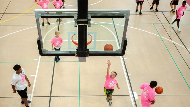 Kids shoot baskets during the 2017 Booth Basketball Academy camp at the RiverPlex in Peoria.