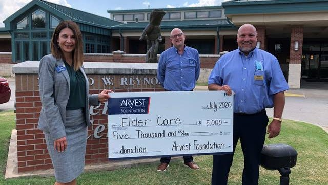 Arvest local bank president Kim Adams, left, and loan manager David Nickel, center, present a check to Cordell Rumsey, Elder Care executive director. Courtesy
