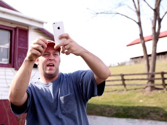 Ricky Short talks about rescuing his dog from a neighbor's property only using the flashlight on his cell phone to locate the dog on the cliff in Churchville on Thursday, March 10, 2016.
