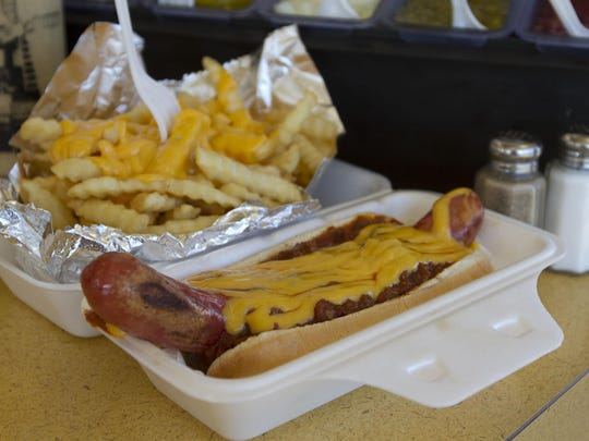 A summertime staple: French fries and a WindMill hot dog.