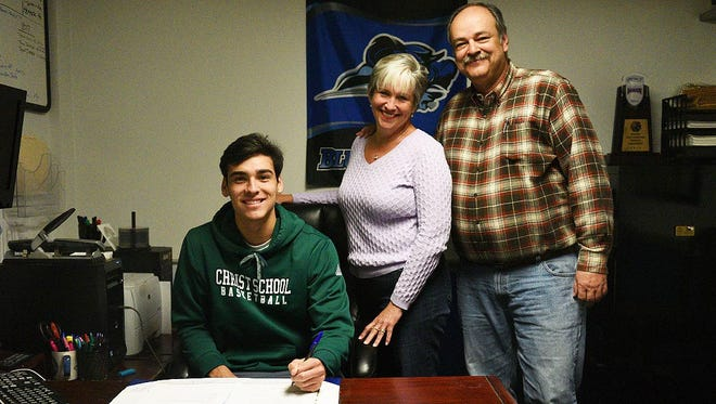 Christ School senior Zach Reeves has signed to play college basketball for Lindsey Reeves (Ky.).