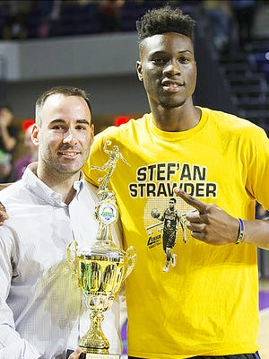 IMG Academy's Emmitt Williams, right, won the dunk contest Sunday at the Culligan City of Palms Classic at the Suncoast Credit Union Arena in Fort Myers.