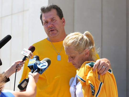 Jim and Donna Nolan speak to the press after the fourth