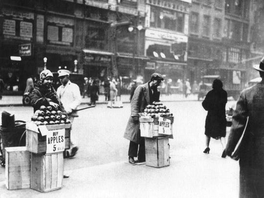Two of New York City's many unemployed people sell apples during the Great Depression in 1930.