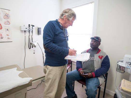 Dr. David Conkle, left, discusses his treatment plan
