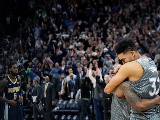 Minnesota Timberwolves' Karl-Anthony Towns, right, and Jeff Teague celebrate after the team's win over the Denver Nuggets in an NBA basketball game Wednesday, April 11, 2018, in Minneapolis. (Carlos Gonzalez/Star Tribune via AP)
