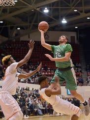 Novi Wildcat Tariq Woody (24) heads for the basket.