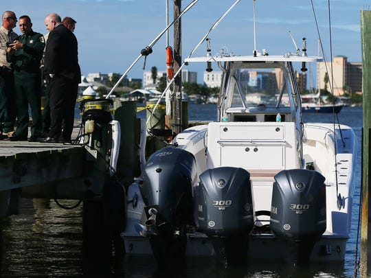 The 33-foot boat involved in a high-speed chase recently is docked Sunday at the U.S. Coast Guard Station on Fort Myers Beach. The boat has three 300-horsepower engines and has an estimated value of $350,000.