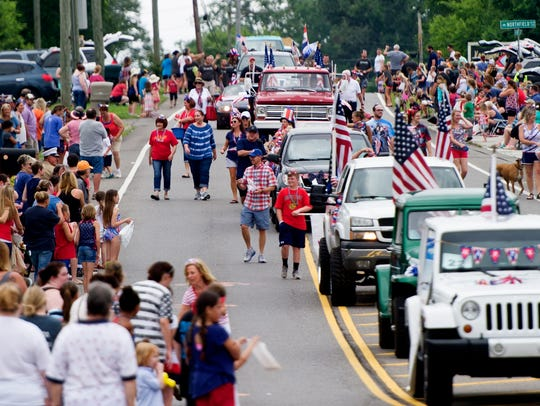 The parade makes its way down Emory Road during the