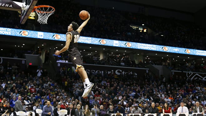 Kickapoo High School (Springfield, Mo.) guard Isaac Johnson dunks during the dunk contest portion of the 2016 Tournament of Champions at JQH Arena.