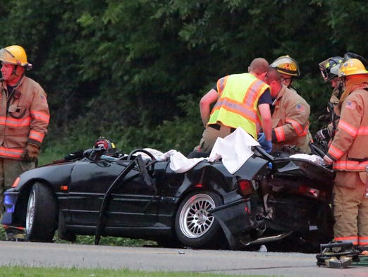 Officials work the scene of an apparent two-car crash on N. 17th Street near Kiwanis Park Saturday July 12, 2014 in Sheboygan.