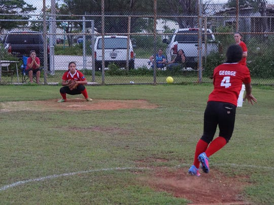Pitcher Audrey George and catcher Sirena Cepeda, left, work together during a Seawalker Guam fastpitch softball practice at George Washington High School on July 15. Seawalker will compete at the Premier Girls Fastpitch National Championships in California in late July.