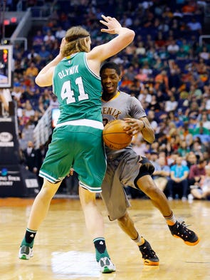 Phoenix Suns guard Brandon Knight (3) runs into Boston