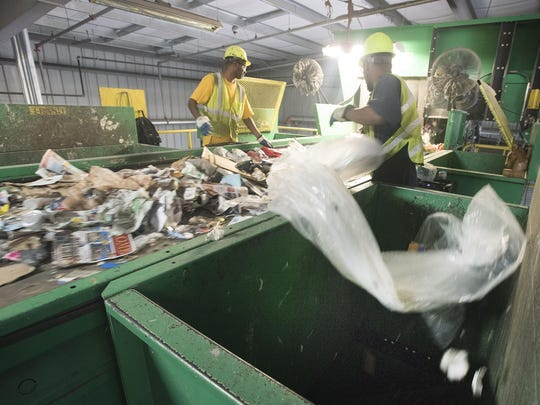 Plastic and plastic bags are cleared out of the material customers considered recyclable at the Resource, Recovery and Recycling Authority of Southwest Oakland County in Southfield. The bags can gum up the machinery.