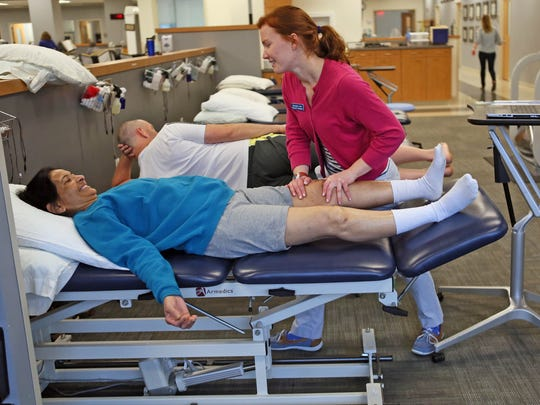 Six weeks out from knee surgery, Chandrika Pathak, of Newark, works with physical therapist Rachel Lins in the University of Delaware's physical therapy program. The program was recently rated #1 in the country by U.S. News and World Report