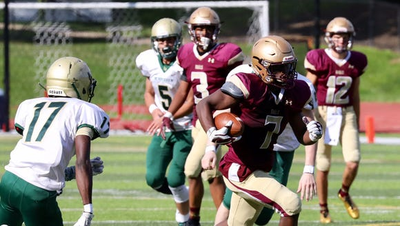 Iona prep's Ki'Shyne Simpson runs upfield with the