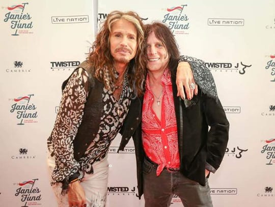 Musician Rick Agosta of Yonkers, right, photographed