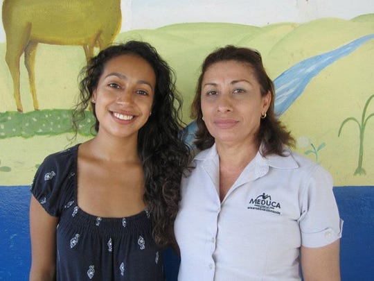 Iowa City native Claudia Garcia, left, poses with one of the teachers she partnered with as a Peace Corps volunteer in Panama from 2012-14.
