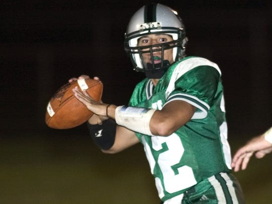 Raritan's Andrew Mandeville looks for an open receive in 2004.