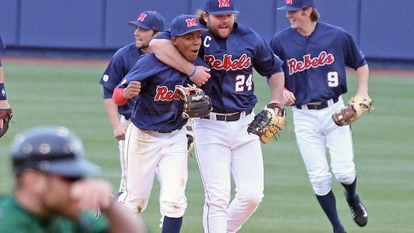 Shortstop Errol Robinson, left, and first baseman Sikes Orvis celebrate a game-ending double play ball for Ole Miss Sunday.