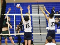 Chambersburg's Dylan Culler (left) and Nathan Walker (right) jump to block a kill by Carlisle's Charlie Shultes during a Mid Penn Commonwealth Division game on Thursday, March 30, 2017 in Chambersburg. The Trojans won 3-0 over Carlisle.