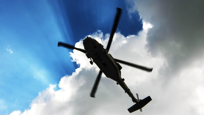 A gunman was killed by police in Oregon after police said he tried to hijack a helicopter.
