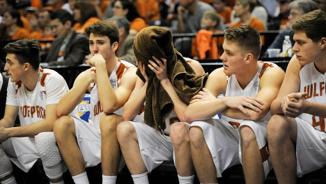 Crawford County sits dejected on the bench as the clock winds down in a loss to Frankton 60-32 on Saturday in the 2017 IHSAA 2A Boys Basketball State Final at Bankers Life Fieldhouse in Indianapolis.  Mar. 25, 2017