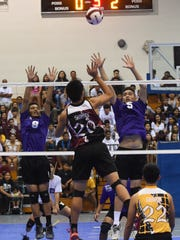 Father Duenas player Leon Shimizu (20) goes up for the spike against George Washington during their Independent Interscholastic Athletic Association of Guam boys' volleyball championship game at Southern High School Gym in Santa Rita on May 14.