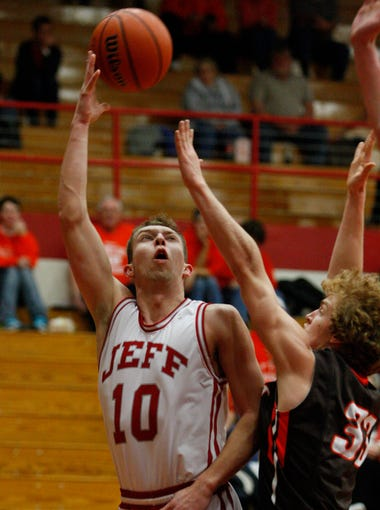 Jeffersonville's Drew Ellis, #10, shoots a layup over Columbus East's Kevin Williams, #33, during their game at the Jeffersonville High School. Feb. 26, 2014