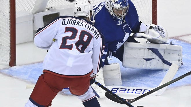 Oliver Bjorkstrand tries to get a shot on Maple Leafs goaltender Frederik Andersen in the playoff qualifying series. Bjorkstrand did not score a goal in that series.