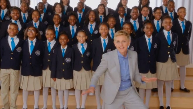 Ellen Degeneres poses with the Detroit Academy of Arts and Science Show Choir in 2014.