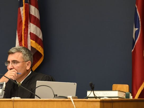 Judge Greg McMillan hears the arguments for Erica Witt