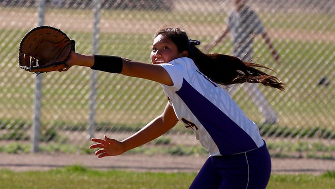 Kirtland Central's Nia Nelson stretches for a catch during a game against Shiprock on Thursday at Kirtland Central High School in Kirtland.