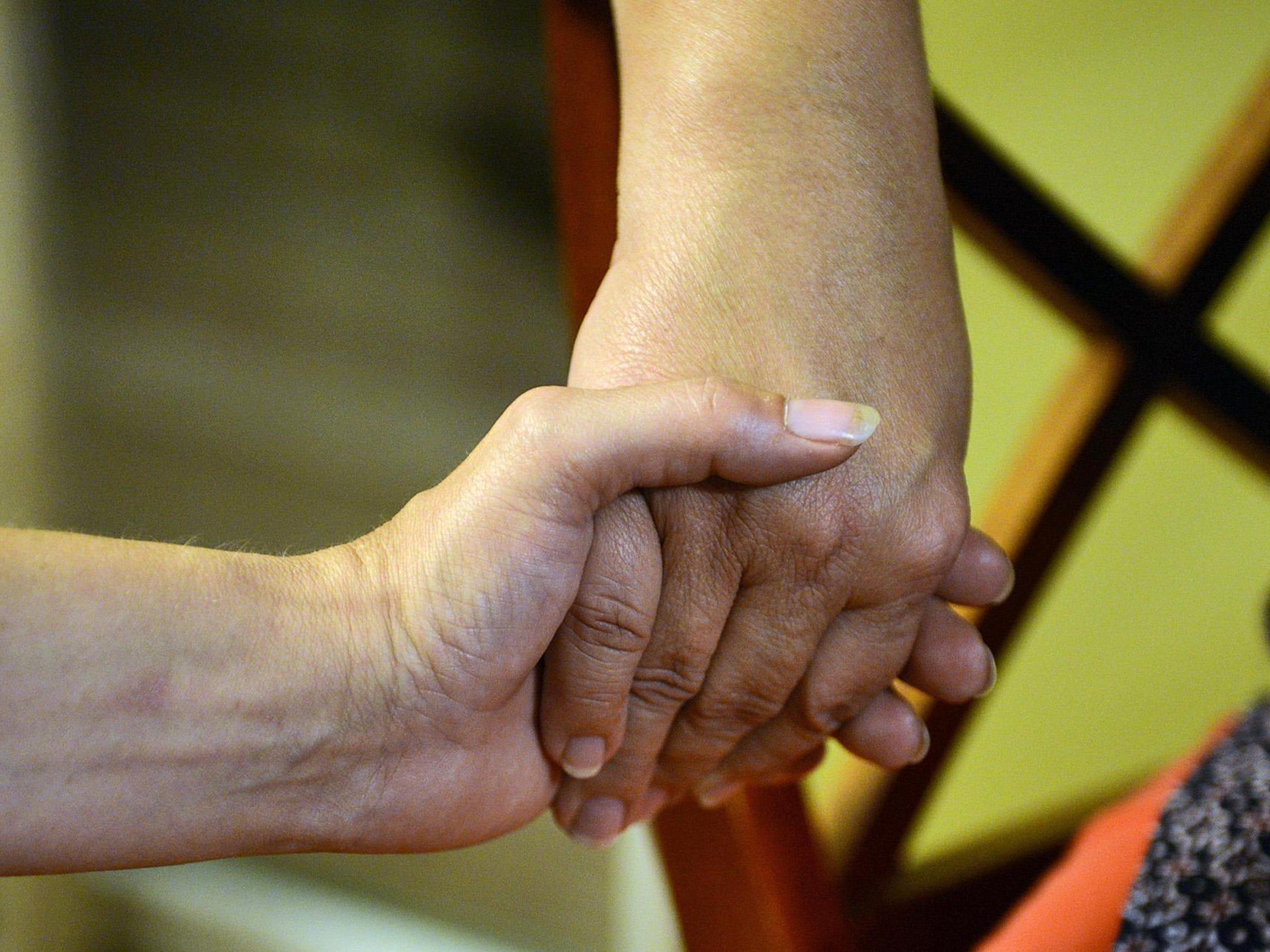 Kim Kruse and Aspa Rigopoulou-Melcher hold hands Aug.