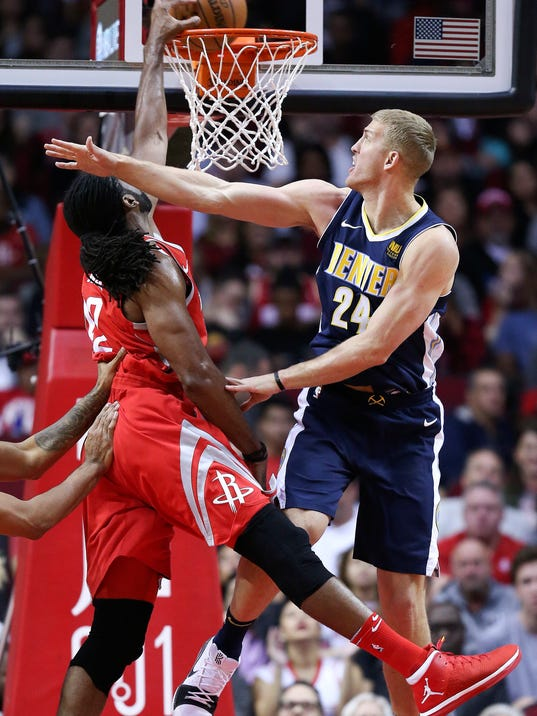 Houston Rockets center Nene Hilario, left, dunks as Denver Nuggets center Mason Plumlee defends during the first half of an NBA basketball game, Wednesday, Nov. 22, 2017, in Houston. (AP Photo/Eric Christian Smith)