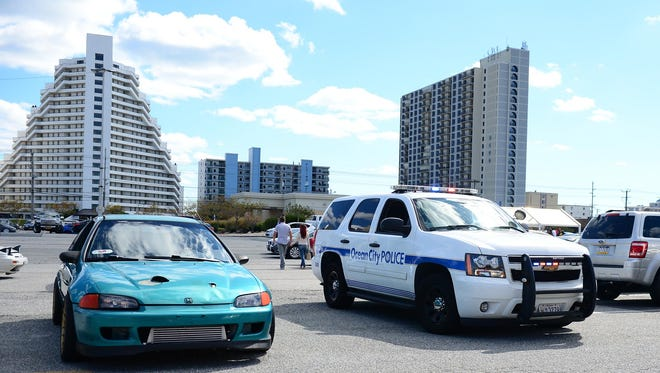 Ocean City Police patrol the parking lot at ACME on 95th Street in Ocean City, Md. where a large crowd of H2Oi enthusiast had gathered on Saturday, Sept. 30, 2017.